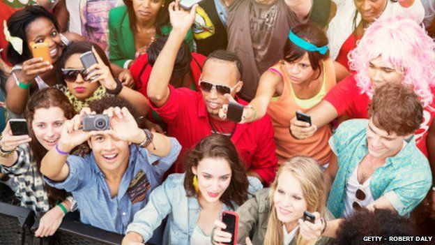 Festival goers using smartphones
