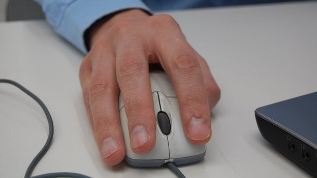 Man holding a computer mouse
