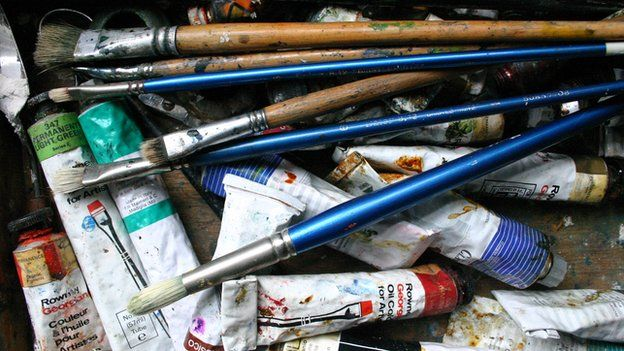 Tubes of paint and brushes