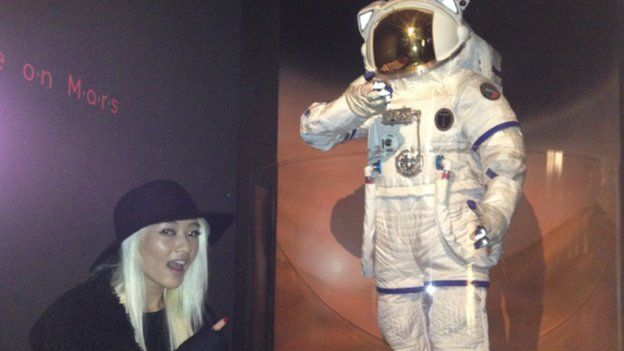 Maggie at the museum with astronaut model