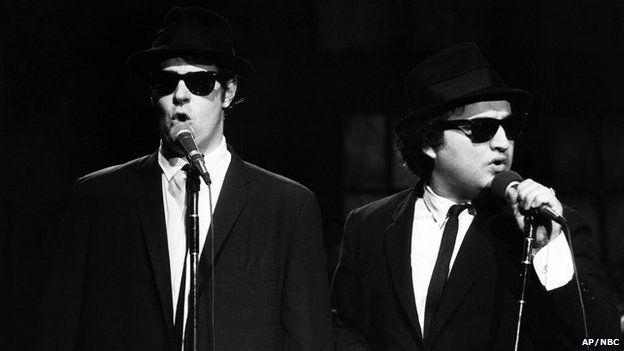 Dan Aykroyd as Elwood Blues and John Belushi as Jake Blues