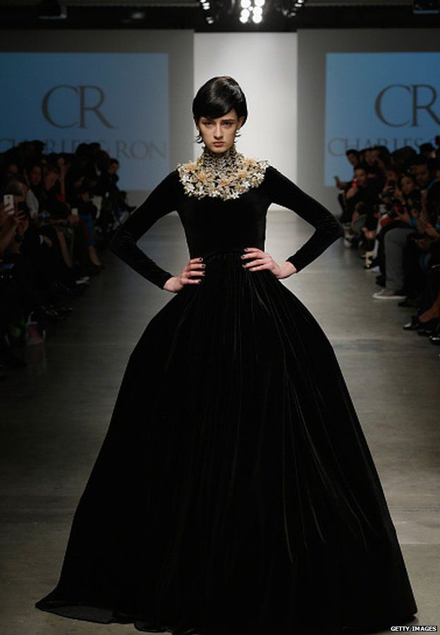 A model walks the runway during the Charles & Ron show at the Nolcha Fashion Week