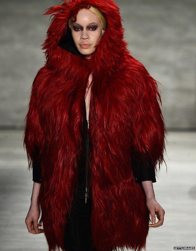A model walks the runway at the Etxeberria fashion show