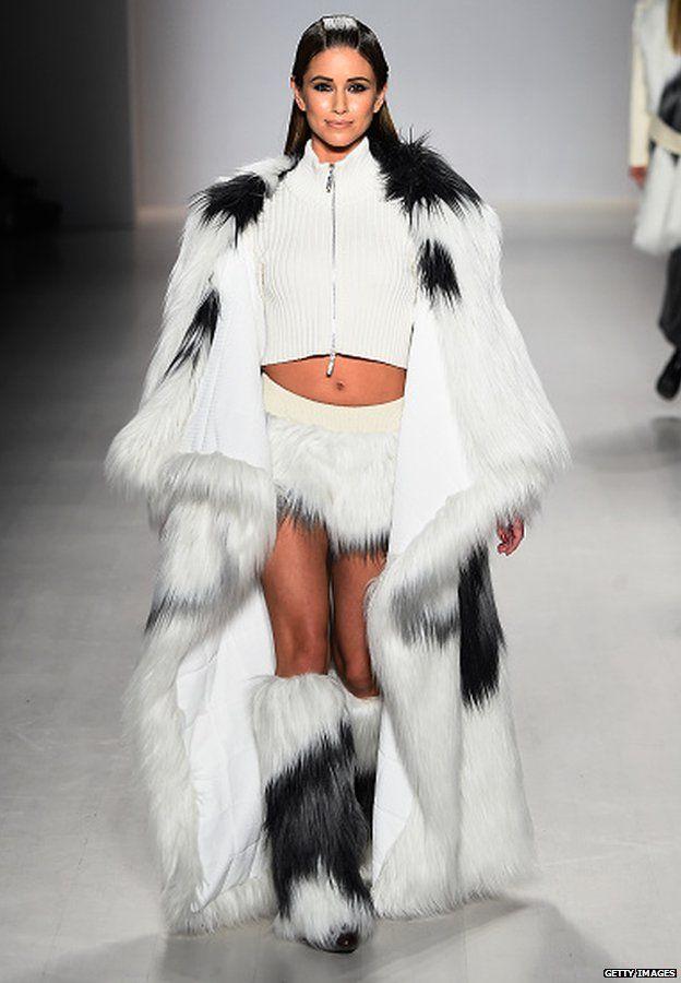 A model walks the runway at the Oudifu fashion show