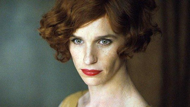 Eddie Redmayne with make-up and a more feminine hairstyle