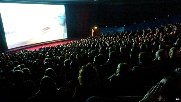 Cinema audience looking at a big screen