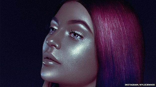 The picture of Kylie Jenner appearing darker than usual with metallic looking skin and pink hair