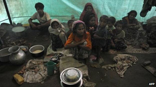 Muslim Rohingyas sitting inside their collective tent at the Dabang Internally Displaced Persons (IDP) camp