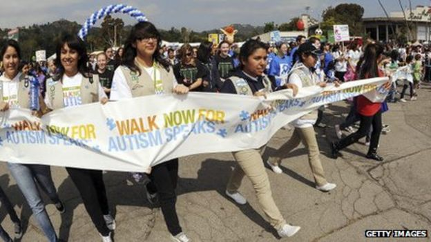 Protesters march for Autism Speaks