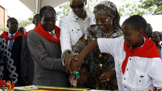 Left: Robert Mugabe and his wife and their two sons prepare to cut a birthday cake for Mr Mugabe's 85th birthday in 2009