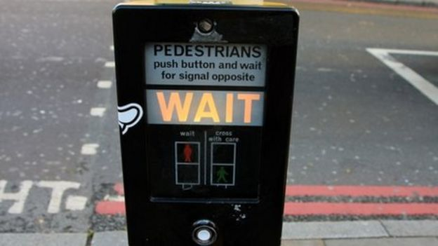 An illuminated wait signal at a pedestrian crossing