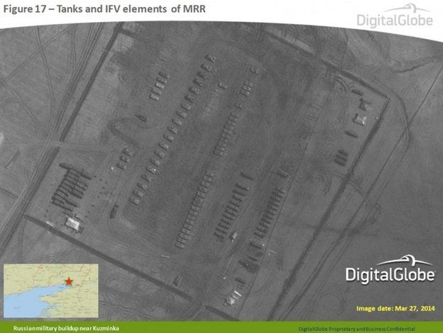 Satellite image taken 27 March 2014, and provided by Supreme Headquarters Allied Powers Europe (SHAPE) on 9 April 2014, shows what are purported to be Russian military tanks and vehicles at a military base near Kuzminka, east of the Sea of Azov in southern Russia.