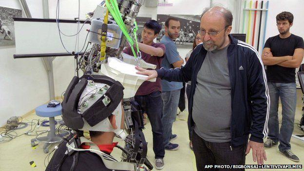 Dr Miguel Nicolelis and paraplegic