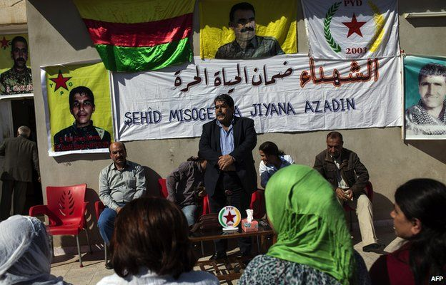 Salih Muslim, head of the Democratic Unity Party (PYD) receives condolences from Syrian Kurds after his son Servan was killed in fighting with jihadist militants (15 October 2013)