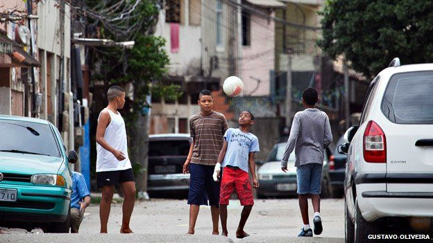 Children play football on a street in Vila Uniao in January 2015