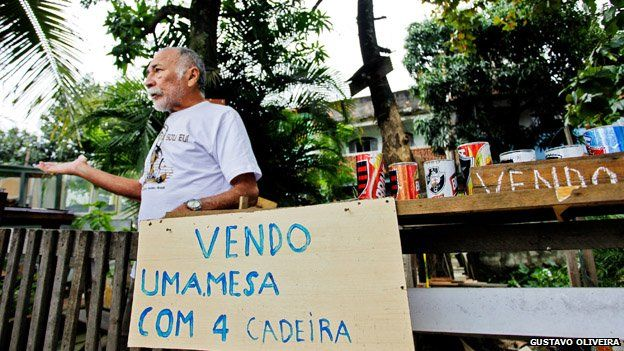 A resident mans a stand in Vila Uniao in January 2015