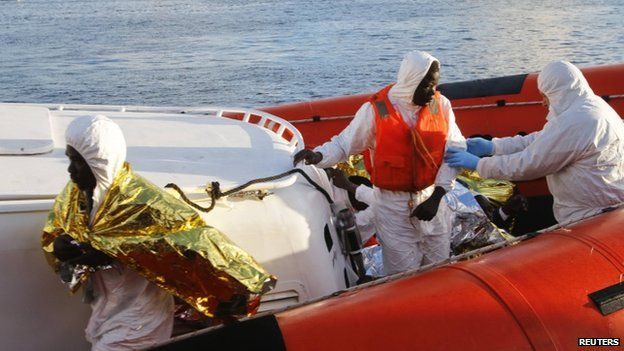 Migrants who survived a shipwreck arrive at the Lampedusa harbour 11 February 2015