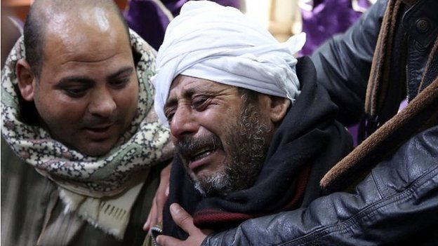 The father of a Coptic Christian killed in Libya weeps over his loss