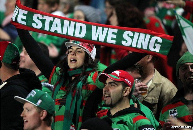 Rabbitoh fans cheer on their team during the round 23 NRL match between the South Sydney Rabbitohs and the Manly Sea Eagles at Bluetongue Stadium on 16 August 2013 in Gosford, Australia