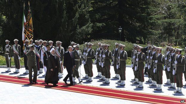 President Erdogan reviews a guard of honour the Saadabad palace in Tehran, Iran