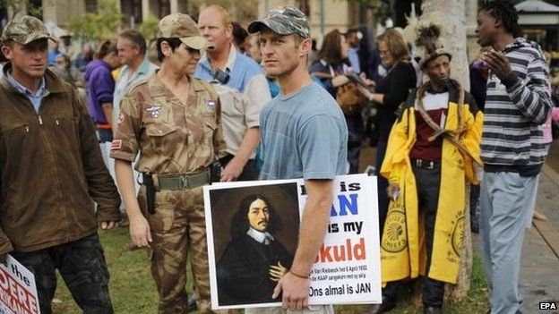A protester with a photo of Jan van Riebeeck in South Africa