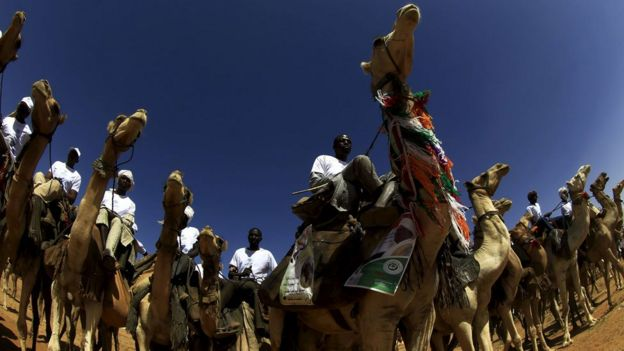 Supporters of Sudan's National Congress Party ride camels to attend a campaign rally at Fasher in North Darfur, Sudan 8 April 2015.