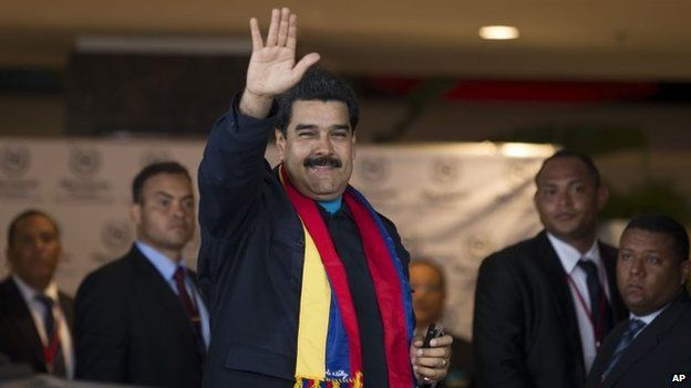 """Venezuela""""s President Nicolas Maduro waves to photographers as he arrives to a hotel in Panama City, Friday, 10 April 2015."""