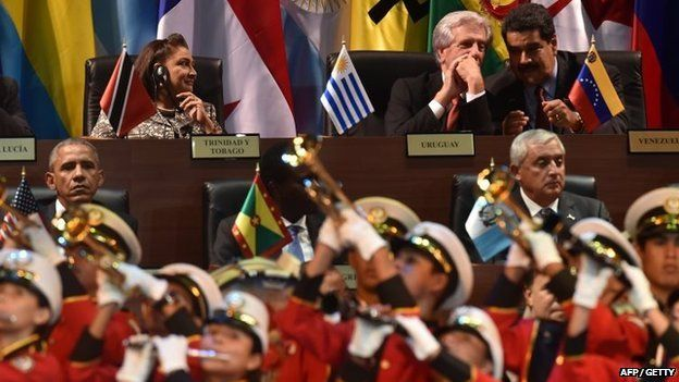Trinidad and Tobago's Prime Minister Kamla Persad-Bissessar, Uruguay's President Tabare Vazquez and Venezuela's President Nicolas Maduro and US President Barack Obama, Grenadian Prime Minister Keith Mitchell and Guatemala's Otto Perez attend the opening ceremony of the Americas Summit in Panama City on 10 April 2015.