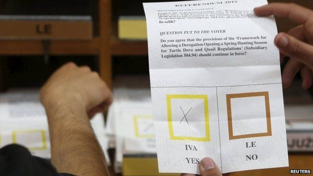 A ballot paper is shown to counting agents during counting in a referendum on spring hunting outside Valletta (12 April 2015)