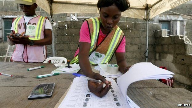 An electoral officer checks through a list during governorship election in Ajah district of Lagos April 11, 2015.