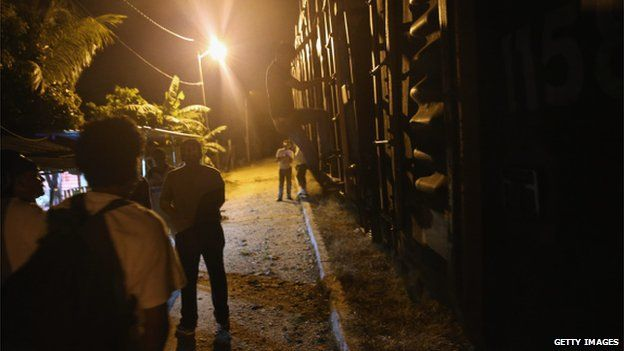 Migrants seek passage on freight train in Mexico