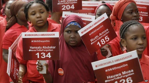 Young girls known as Chibok Ambassadors carry placards bearing the names of the girls kidnapped from the government secondary school in Chibok a year ago, during a demonstration in Abuja, Nigeria, 14 April 2015