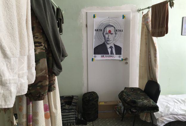Poster of President Putin on a target in Ukrainian soldiers' rooms of the plant