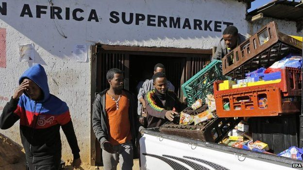 Ethiopian shop owners remove all their belongings from their shop after xenophobic violence in the area in Actonville, Johannesburg, South Africa, 16 April 2015