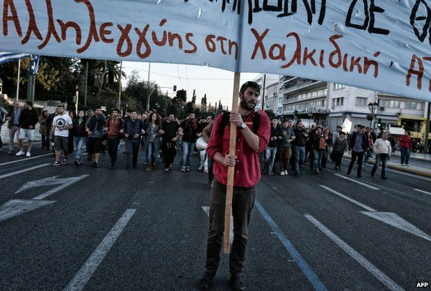 """Opponents of an important gold mine project in northern Greece march in central Athens on 16 April 2015 holding a banner reading """"Support to Halkidiki"""