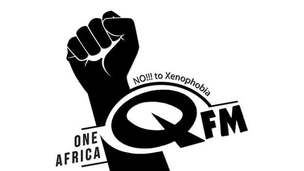 picture of QFM radio logo with no to xenophobia caption