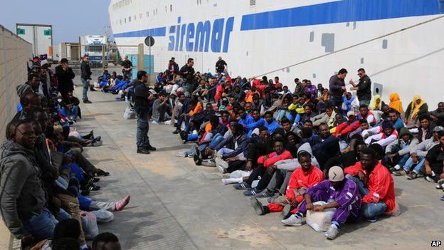 File photo: Migrants waiting to board on a cruise ship as they leave the island of Lampedusa, Southern Italy, to be transferred in Porto Empedocle, Sicily, 17 April 2015