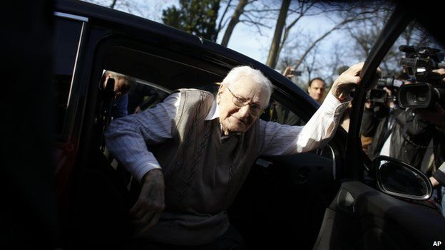Former SS guard Oskar Groening steps out of a car as he arrives at the back entrance of the court hall prior to a trail against him in Lueneburg, northern Germany, 21 April 2015