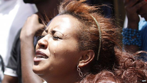 An Ethiopian woman mourns relatives and friends killed in Libya by Islamic State (21 April 2015)