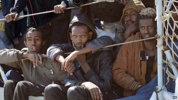 Migrants wait to disembark from an Italian ship in Salerno, Italy. Photo: 22 April 2015
