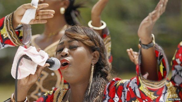 "A Christian faithful from the World Victory Centre sings hymns during an Easter crusade service for the victims of the Garissa University attack in Kenya""s capital Nairobi 5 April 2015"