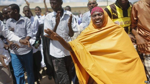 Muslim residents of Garissa chant Down with al-Shabab as they take to the street to protest against attack on the Garissa University College in Garissa town,