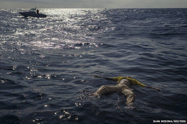 The body of a drowned migrant floats in the sea near the coast of Fuerteventura, one of Spain's Canary Islands January 18, 2004.