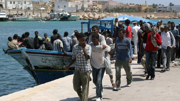 Eritrean migrants arrive in the port of Italy's southern island of Lampedusa