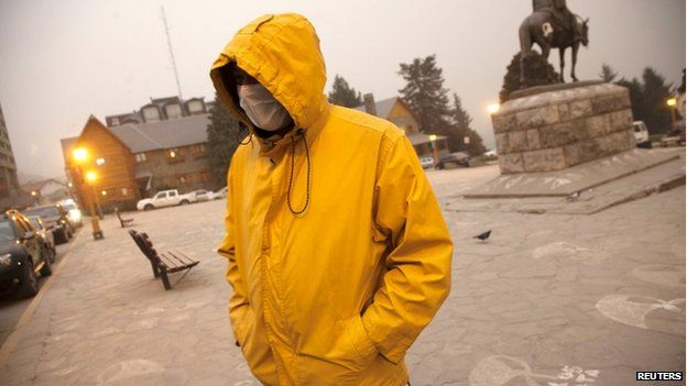 A resident walks by the Centro Civico (Civic Centre) covered with ash from the Calbuco volcano in the Patagonian Argentine city of San Carlos de Bariloche 23 April 2015
