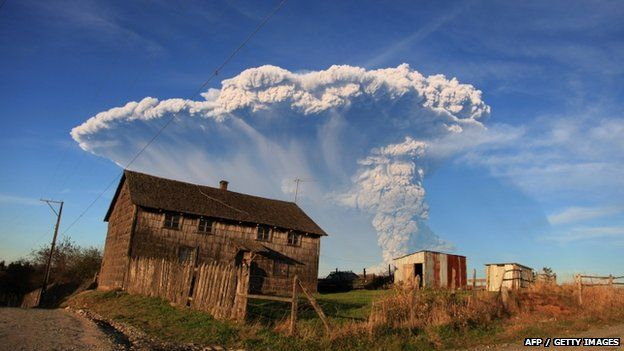 View from Puerto Montt, southern Chile, of a high column of ash and lava spewing from the Calbuco volcano, on 22 April 2015