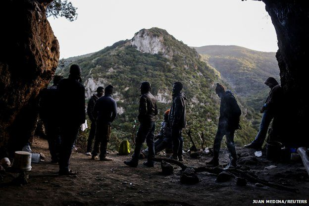 African migrants stand at their hiding place in the mountains - 2014