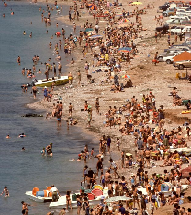 Holidaymakers on a beach in Greece, 1977