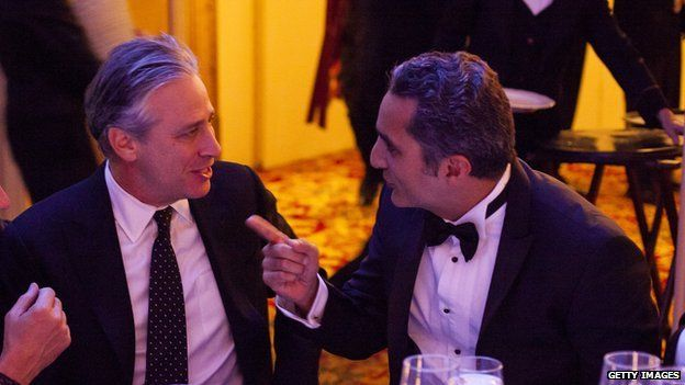 Jon Stewart and Bassem Youssef at a dinner 26 November 2013
