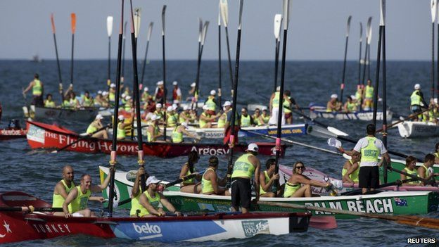 In Sydney dozens of surf boats from Australia, New Zealand and Turkey raise their oars in tribute